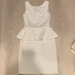 White peplum cocktail dress